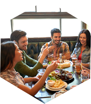 Group of happy people dining